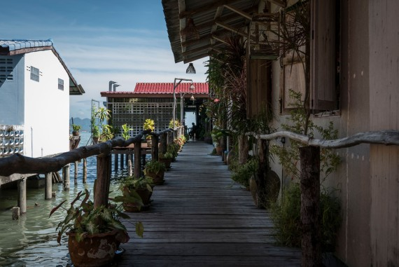 Traditional shops and houses are built out over the water all over Thailand.