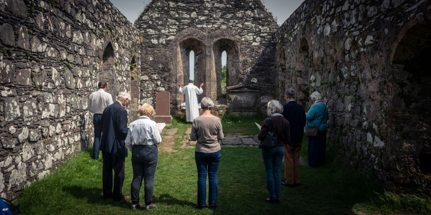 An open air service in the abandoned Kidalton Old Parish church.